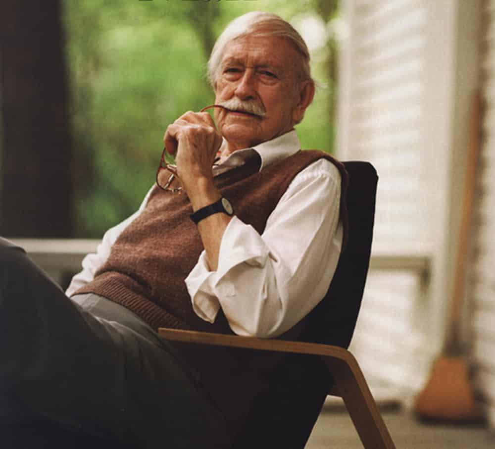 Ralph Rapson sitting in rocking chair