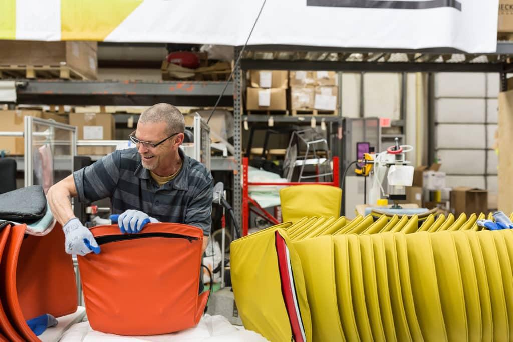 Rodney Esseltine upholstering slam chairs